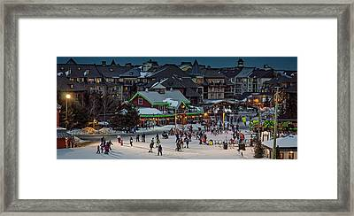 Skiing At The Village Framed Print