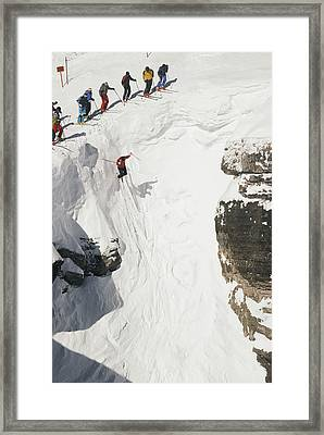 Skilled Skiers Plunge More Than 15 Feet Framed Print by Raymond Gehman