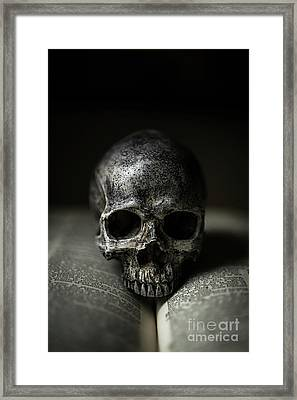 Skull On Book Framed Print by Edward Fielding