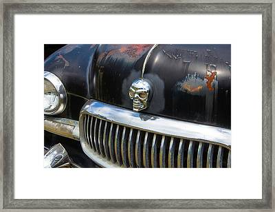Skull On The Hood Framed Print
