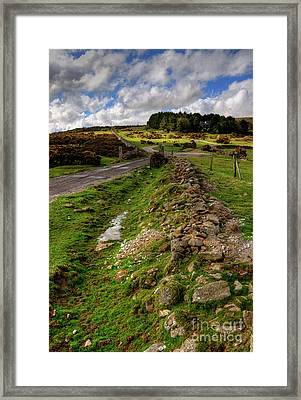 Sky On The Tor  Framed Print by Rob Hawkins