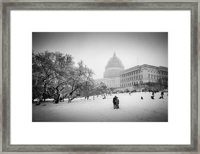 Sledding On Capitol Hill Framed Print by Robert Davis