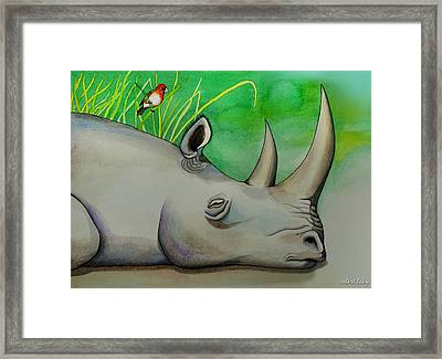 Sleeping Rino Framed Print by Robert Lacy