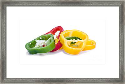 Sliced Colorful Peppers Framed Print by Meirion Matthias