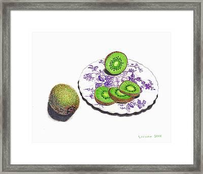 Sliced Kiwi Framed Print by Loraine LeBlanc