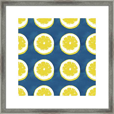Sliced Lemons On Blue- Art By Linda Woods Framed Print by Linda Woods