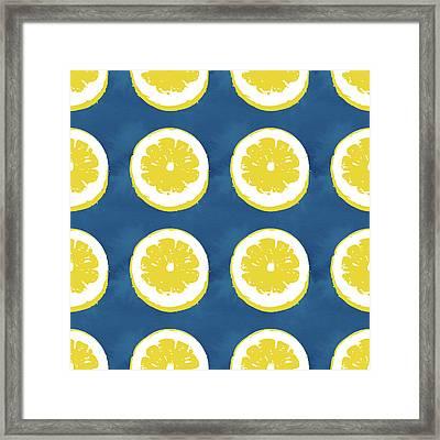 Sliced Lemons On Blue- Art By Linda Woods Framed Print