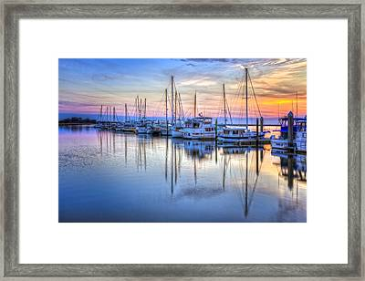 Sliding Into Sunset Framed Print by Debra and Dave Vanderlaan