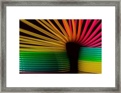 Slinky Framed Print