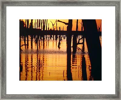 Slue Sunset Framed Print by Myrna Salaun