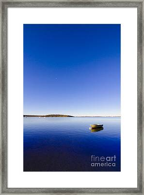 Small Boat Anchored Out To Sea Framed Print by Jorgo Photography - Wall Art Gallery
