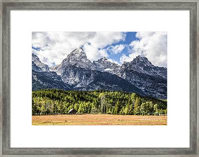 Small Cabin Below Big Mountain Framed Print