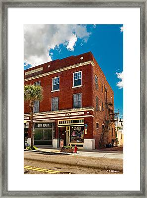 Small Town Shops Framed Print by Christopher Holmes