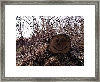 Smiley Log Framed Print by Anna Villarreal Garbis