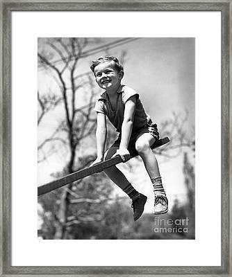 Smiling Boy On Seesaw, C.1930s Framed Print by H. Armstrong Roberts/ClassicStock