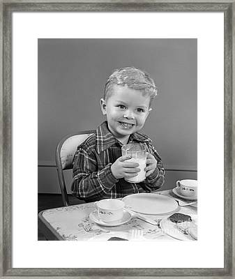 Smiling Boy With Glass Of Milk, C.1950s Framed Print by H. Armstrong Roberts/ClassicStock
