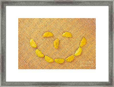 smiling face of Wasabi rice crackers Framed Print by Arletta Cwalina