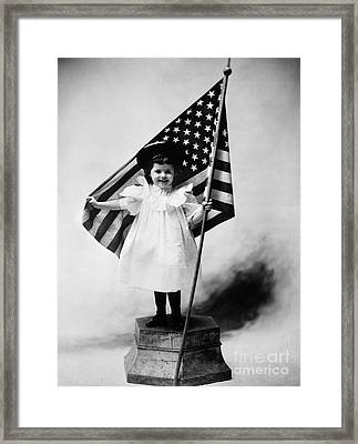 Smiling Little Girl With Us Flag Framed Print by H. Armstrong Roberts/ClassicStock