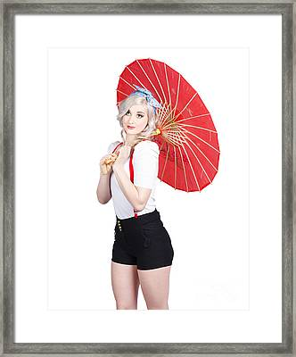 Smiling Retro Woman Holding A Red Umbrella  Framed Print