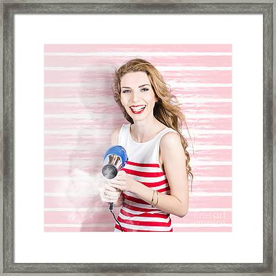 Smiling Stylist With Hair Dryer At Beauty Salon Framed Print