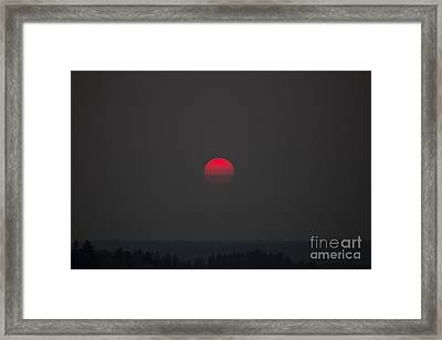 Smokey Red Sun Framed Print