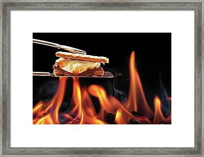 Smore Cooking Over Campfire Framed Print by Susan Schmitz