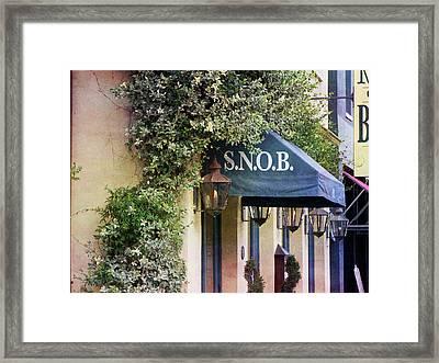 Snob Framed Print