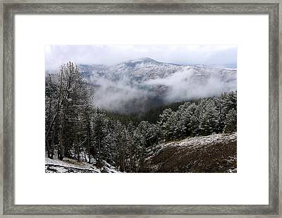 Snow And Clouds In The Mountains Framed Print by Larry Ricker