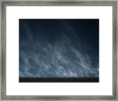 Snow Blown Off A Roof Framed Print