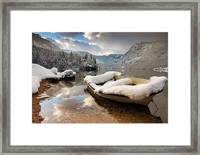 Snow Covered Boat On Lake Bohinj In Winter Framed Print