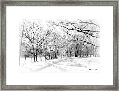 Snow Covered River Road Framed Print by Kathy M Krause