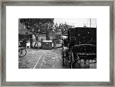 Snow Falling On The Buggy Framed Print by John Rizzuto