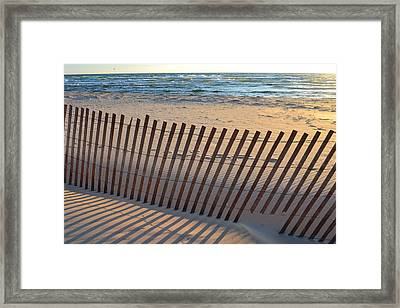 Framed Print featuring the photograph Snow Fence On Lake Michigan by Michelle Calkins
