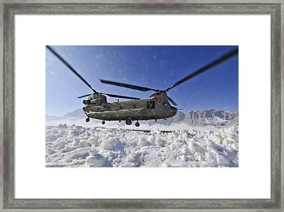 Snow Flies Up As A U.s. Army Ch-47 Framed Print