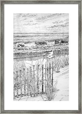 Snow On The Beach Framed Print by Janice Petrella-Walsh