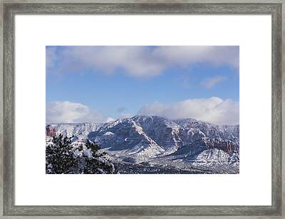 Snow Rim Framed Print
