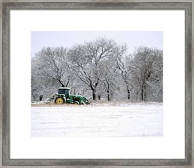 Snow Tractor Framed Print