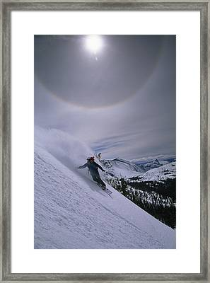 Snowboarding Down A Peak In Yosemite Framed Print