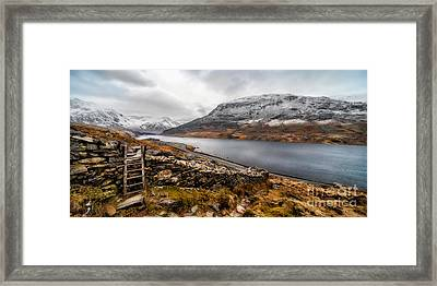 Snowcapped Valley Framed Print by Adrian Evans