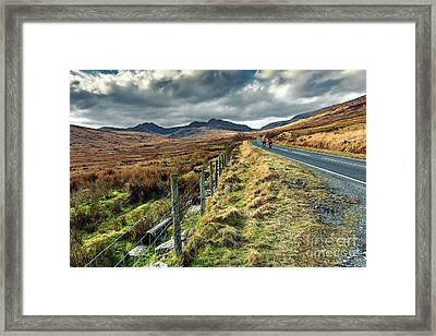 Snowdon Cyclists Framed Print by Adrian Evans