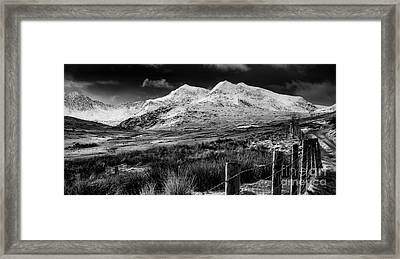 Snowdon Winter Framed Print by Adrian Evans