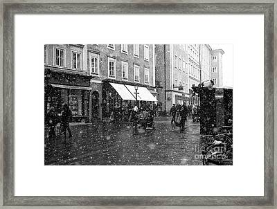Snowflakes In Salzburg Framed Print by John Rizzuto