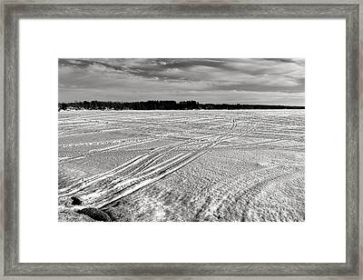 Snowmobile Tracks On China Lake Framed Print by Olivier Le Queinec