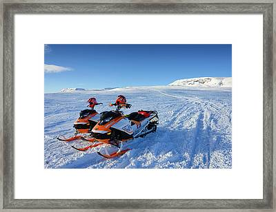 Snowmobiles In Iceland In Winter Framed Print by Matthias Hauser