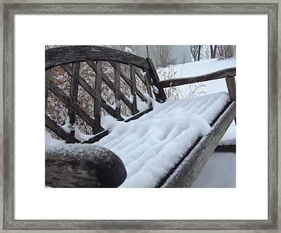 Snowy Bench Framed Print