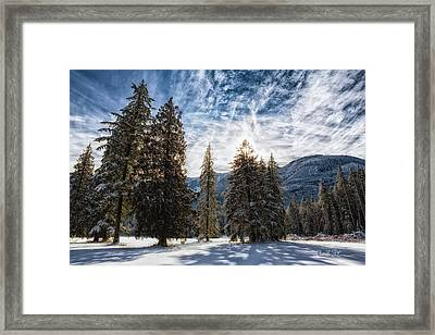 Snowy Clouds Framed Print by Charlie Duncan