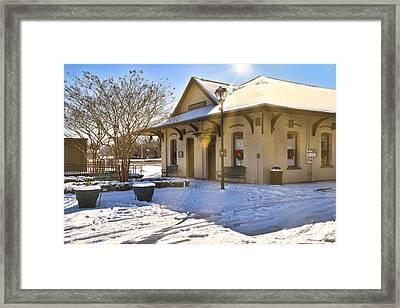 Snowy Depot Framed Print