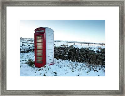 Snowy Telephone Box Framed Print by Helen Northcott
