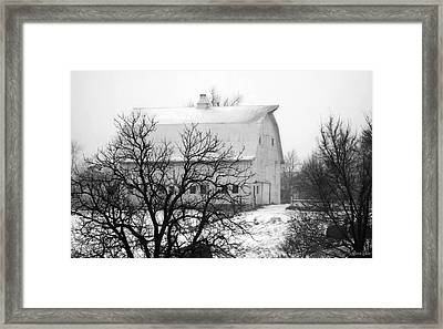Snowy White Barn Framed Print