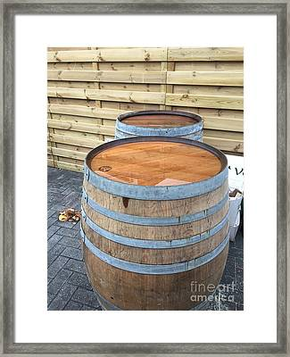 Soaked Barrels Framed Print by Evan N